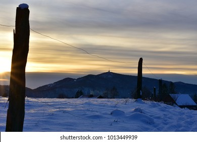 Winter landscape in snow nature with sunset and  hill Kum for the background