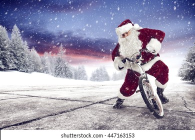 winter landscape of snow trees and road with santa claus