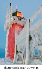 Winter landscape of the South Haven, Michigan Lighthouse and catwalk glazed in ice, Lake Michigan, USA