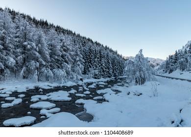 Winter landscape stones snow covered white