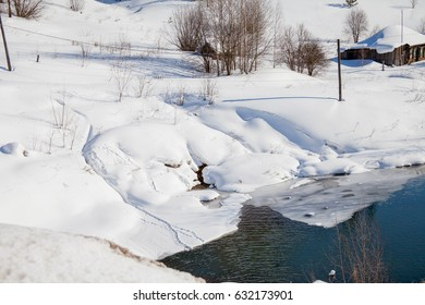 Winter landscape with a stream and a hut on the mountain, Perm, Russia