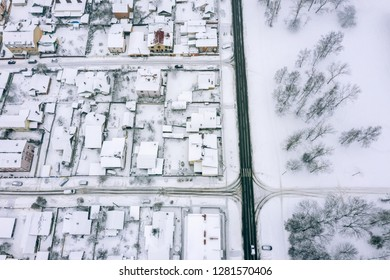 winter landscape. suburb residential area covered with snow. birds eye view