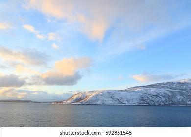 Winter landscape at sunrise   Norwegian sea near Tromso North of Norway