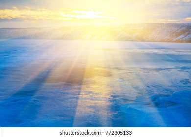 winter landscape with sunrise over frozen lake