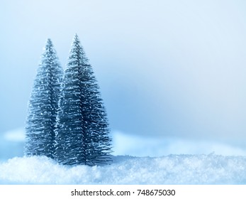 Winter landscape with two trees colored in cold blue with space for text or image