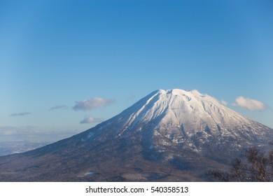 Winter landscape under the blue sky of Mt.Yotei, the stratovolcano in Niseko Annupuri Ski Area, Hokkaido, Japan