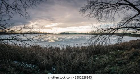 Winter landscape view of the frozen pond in Czechia