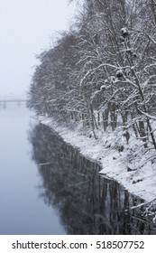 Winter landscape with water