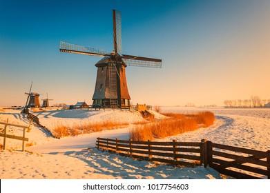 Winter landscape with windmills in Schermerhorn Netherlands