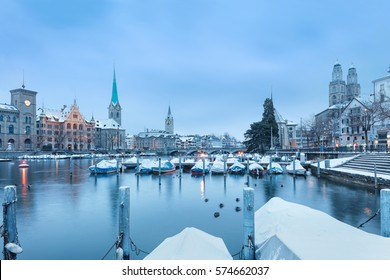 Winter landscape of Zurich with lake with boats on foreground, Switzerland