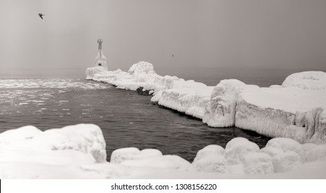 Winter Lighthouse. Sakhalin. The South-Western coast of Sakhalin island. Black and white.