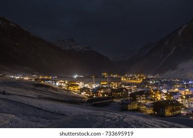 Winter Livigno resort in the night. Alpine hills in Italy