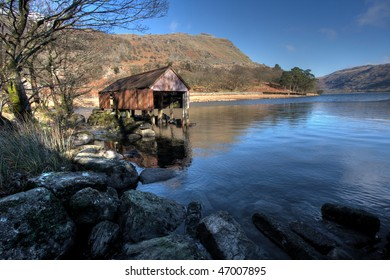 Winter at Llyn Gwynant with ice on the water Snowdonia national park