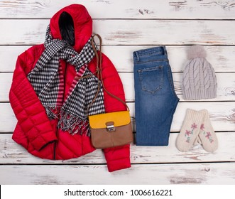 Winter look for a schoolgirl. Bright red jacket, checkered scarf, jeans, leather bag and handmade set of hat and gloves.