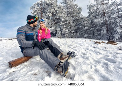 winter love -couple enjoying on winter vacation together on the snow mountain