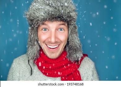 winter man looking snow flakes