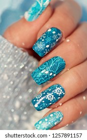 Winter manicure with nail stickers made close-up on the female hand.Nail art.Slider.