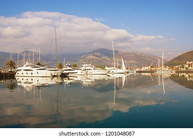 Winter Mediterranean landscape. Montenegro, Adriatic Sea, Bay of Kotor. View of Porto Montenegro - yacht marina  in Tivat city