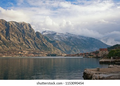 Winter Mediterranean landscape. Montenegro, Bay of Kotor ( Adriatic Sea ). View of Lovcen mountain and Prcanj town