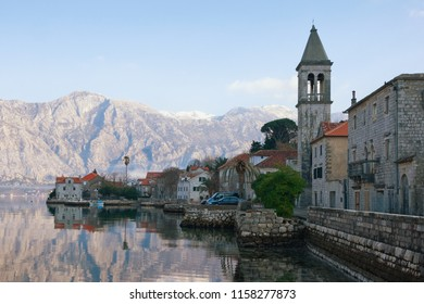 Winter Mediterranean landscape. Montenegro, Bay of Kotor, Adriatic Sea. View of ancient town of Stoliv and Name of Mary Church
