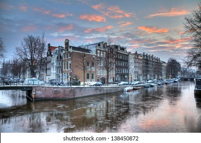 Winter morning canal in Amsterdam, the Netherlands, a UNESCO world heritage site. HDR