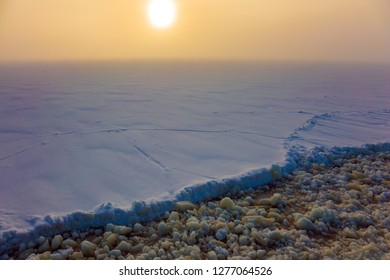 Winter morning in Lapland. Excursion to the Arctic sea icebreaker. The icebreaker moves forward, leaving behind the ice crumb. The concept of active and extreme tourism