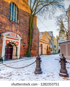 Winter morning in medieval street of old city of Riga - the capital and largest city of Latvia, a major commercial, cultural, historical and tourist center of the Baltic region