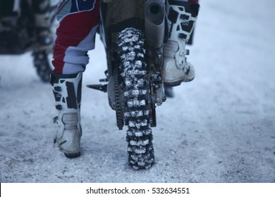 winter motocross racer motorcyclist at the start of the race