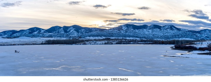 Winter Mountain Lake - A panoramic sunset view of frozen solid Bear Creek Lake at the foothill of Front Range of Rocky Mountains. Denver-Lakewood, Colorado, USA.