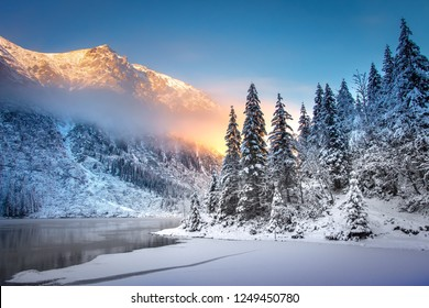Winter Mountain landscape of Morskie oko in Tatra national park at sunrise. Icy Sea Eye lake in Tatra mountains
