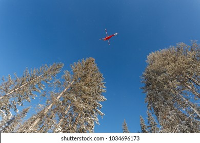 Winter mountain landscape, rescue helicopter is looking for tourists which called for help, Tatry Mountains, Poland