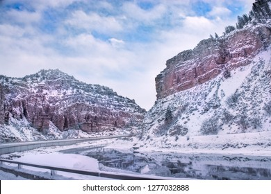 Winter mountain landscape. River flowing along snow capped mountains. Glenwood Canyon, Glenwood Springs, Colorado, USA.