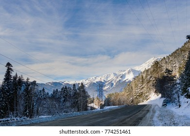 Winter mountain landscape with road and snow