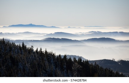 winter mountain landscape view with valleys hidden in beautiful morning fog early in the morning