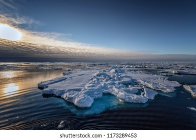 Winter mountain nature Svalbard Longyearbyen Svalbard Norway with blue sky and snowy peaks on a sunny day wallpaper during sunset sunrise orange fire.