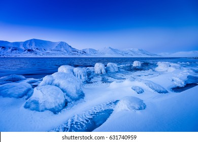 Winter mountain nature Svalbard Longyearbyen Svalbard Norway with blue sky and snowy peaks on a sunny day wallpaper during sunset