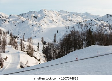 Winter mountain panorama, landscape. Ski center on top of the Vogel mountain in Slovenia. A famous ski resort in the Slovenian mountains of the Julian Alps. Snow-covered ski slope, chair lift. Europe