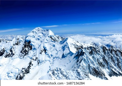 Winter mountain peak snow view. Snowy winter mountain peak snow. Winter mountain peak snow. Snow covered winter mountain peak landscape - Shutterstock ID 1687136284