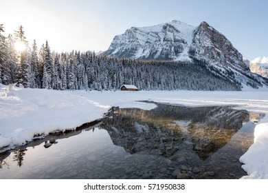Winter mountain reflection in the calm clear water at Lake Louise in Banff National Park, Alberta, Canada