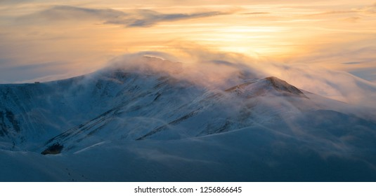 Winter mountain ridge at th evening. Carpathians, Ukraine