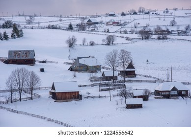 Winter mountain village landscape with snow covered houses