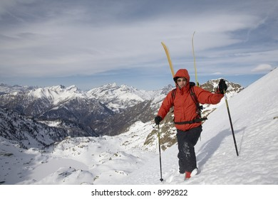 Winter mountaineering in wilderness area: male climber, exploring and adventure concept.