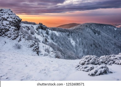 winter mountains colorful sunrise panorama from Klak hill in Mala Fatra mountains in Slovakia. Near town Bojnice and Prievidza.
