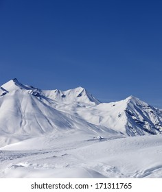 Winter mountains at nice sun day. Caucasus Mountains, Georgia, ski resort Gudauri.