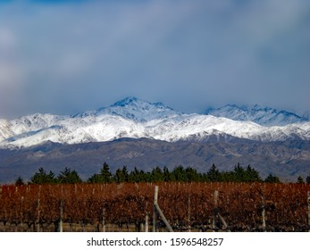 winter mountains overlooking vineyard in Mendoza Argentina