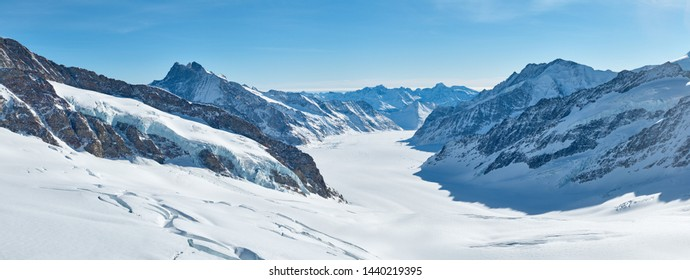 Winter mountains panorama with Aletsch glacier covered by the snow. View from Jungfraujoch in Bernese oberland in Switzerland.
