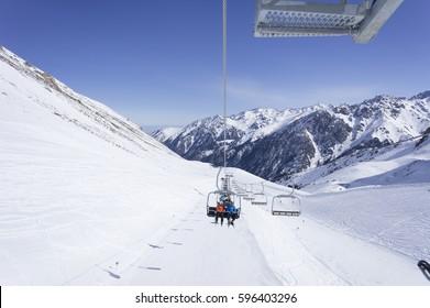 Winter mountains, panorama - snow-capped peaks. Ski lift