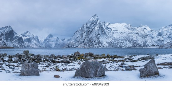 Winter mountains panorama view with stones at foreground, Norway, Lofoten islands