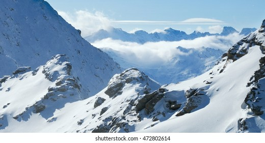 Winter mountains panoramic view with clouds in the valley. Corvatsch, Engadin, Switzerland.