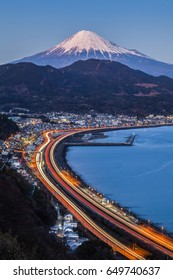 Winter Mt. Fuji with Long exposure of Tomei expressway at Suruga Bay , Shimizu Town , Shizuoka prefecture.